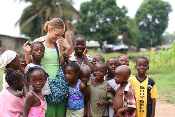 """Sinkor, Liberia - July 2, 2009. A young American missionary lady interacting with the children of this suburb of the capital city, Monrovia."""